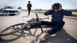 Cyclist knocked off bike by car